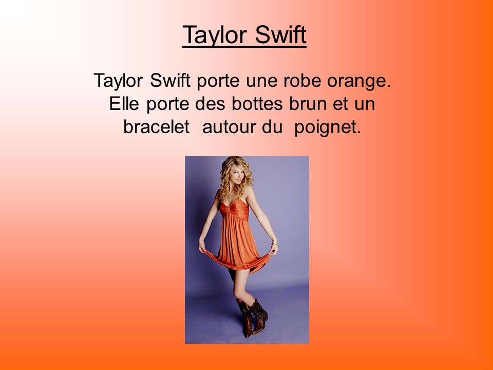 Taylor Swift Taylor Swift porte une robe orange.