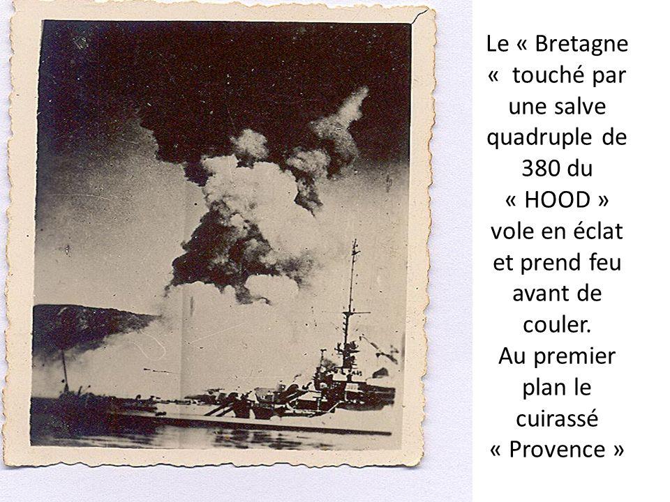 Le « Bretagne « touché par une salve quadruple de 380 du « HOOD » vole en éclat et prend feu avant de couler.