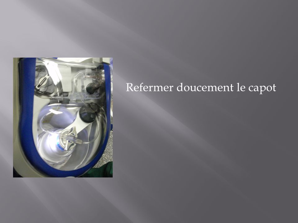 Refermer doucement le capot