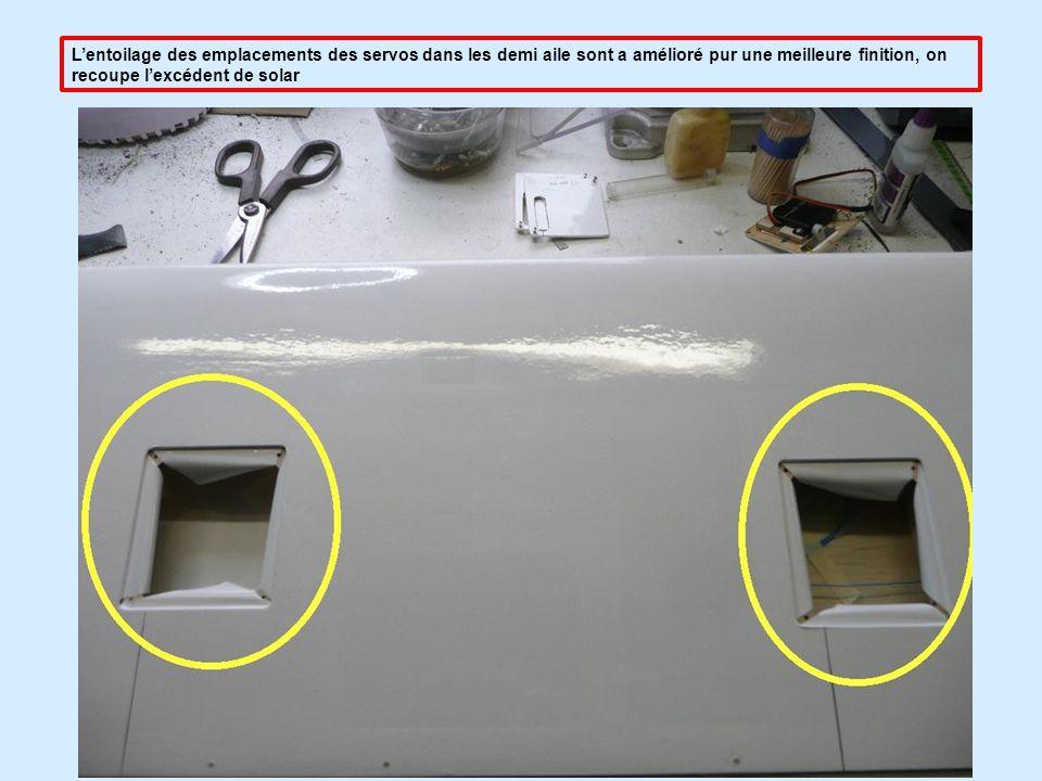 L'entoilage des emplacements des servos dans les demi aile sont a amélioré pur une meilleure finition, on recoupe l'excédent de solar
