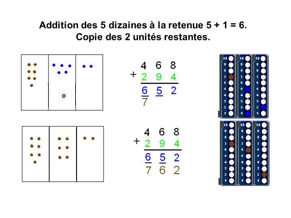 Addition des 5 dizaines à la retenue 5 + 1 = 6