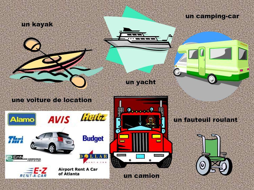 un camping-car un kayak un yacht une voiture de location un fauteuil roulant un camion