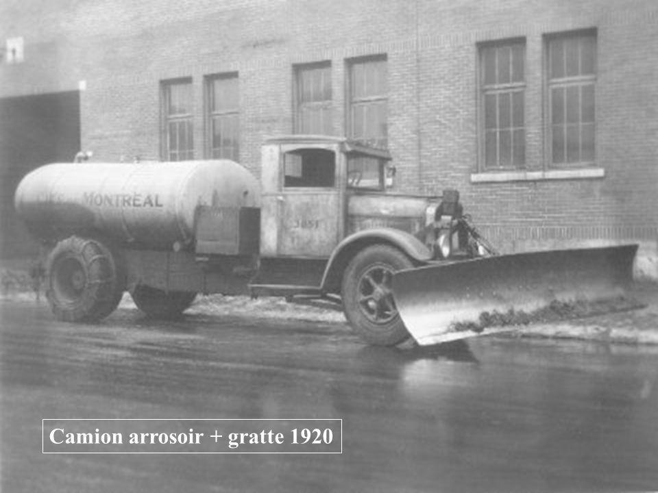 Camion arrosoir + gratte 1920