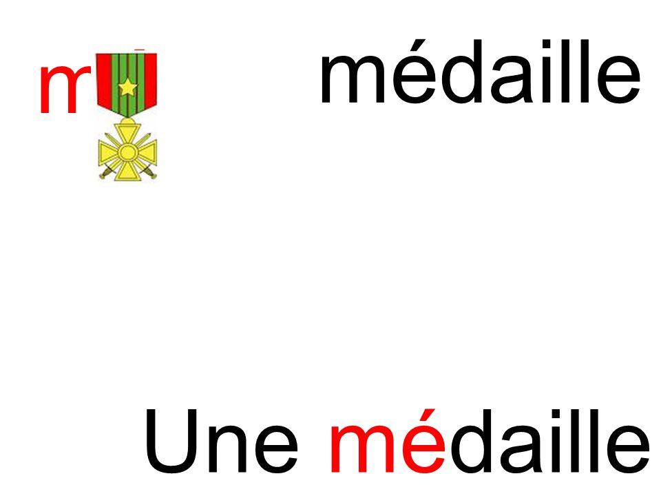 médaille mé Une médaille