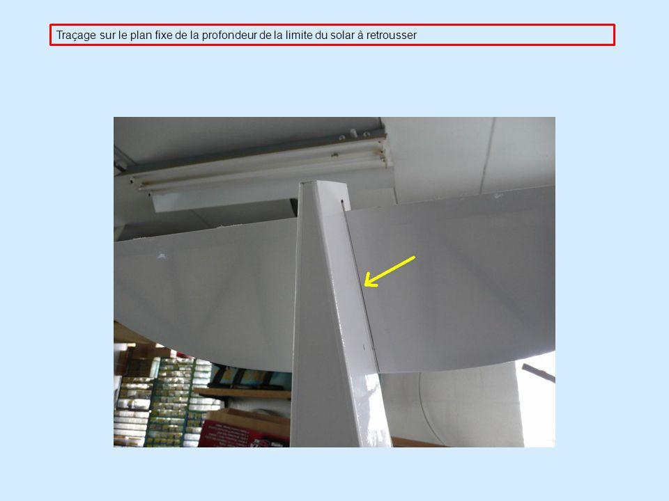 Traçage sur le plan fixe de la profondeur de la limite du solar à retrousser