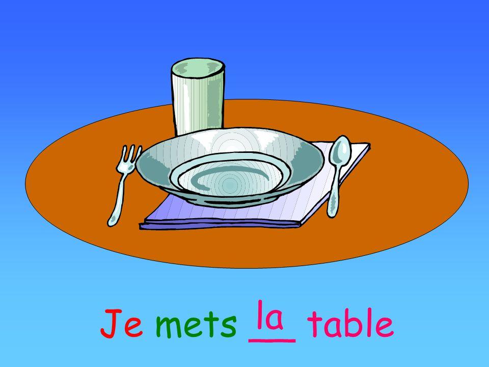 la Je mets __ table