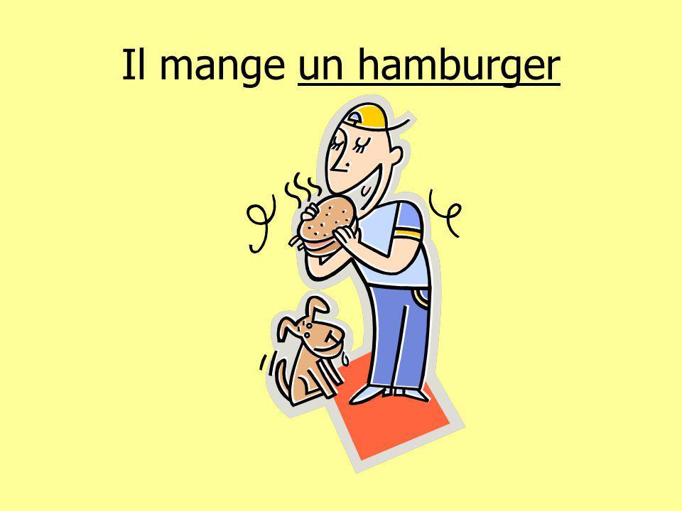 Il mange un hamburger