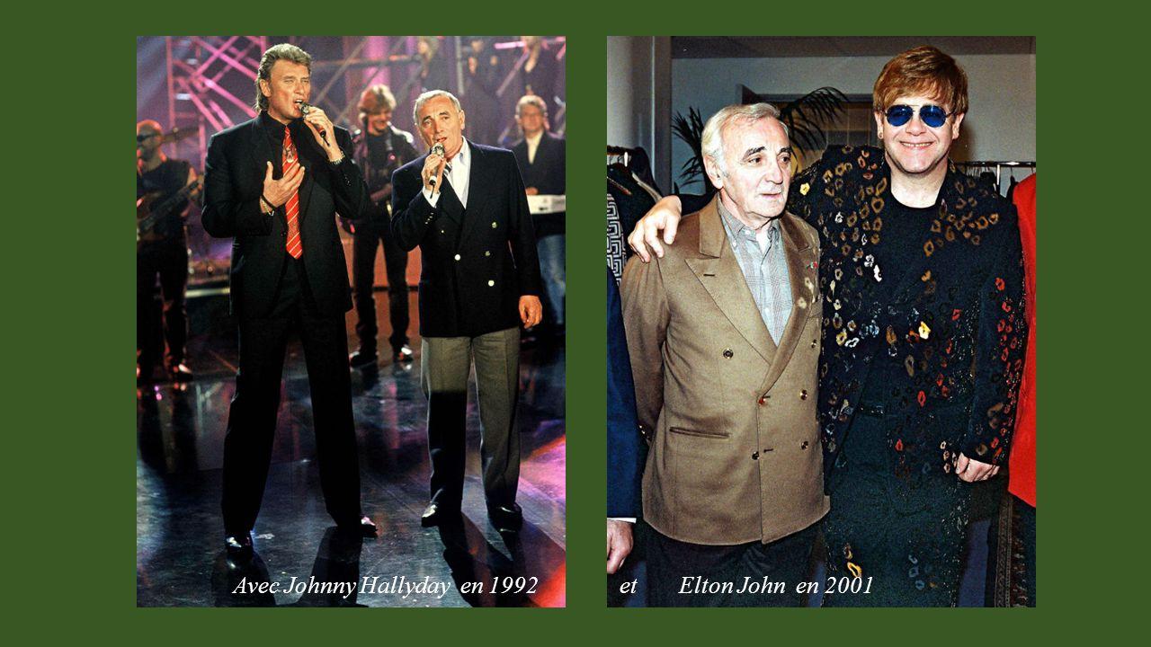 Avec Johnny Hallyday en 1992 et Elton John en 2001