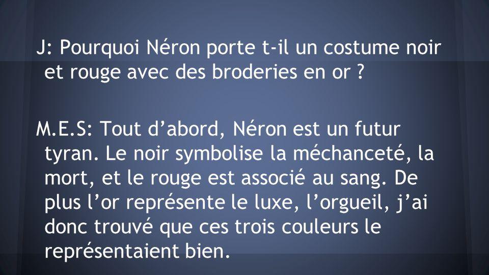 J: Pourquoi Néron porte t-il un costume noir et rouge avec des broderies en or