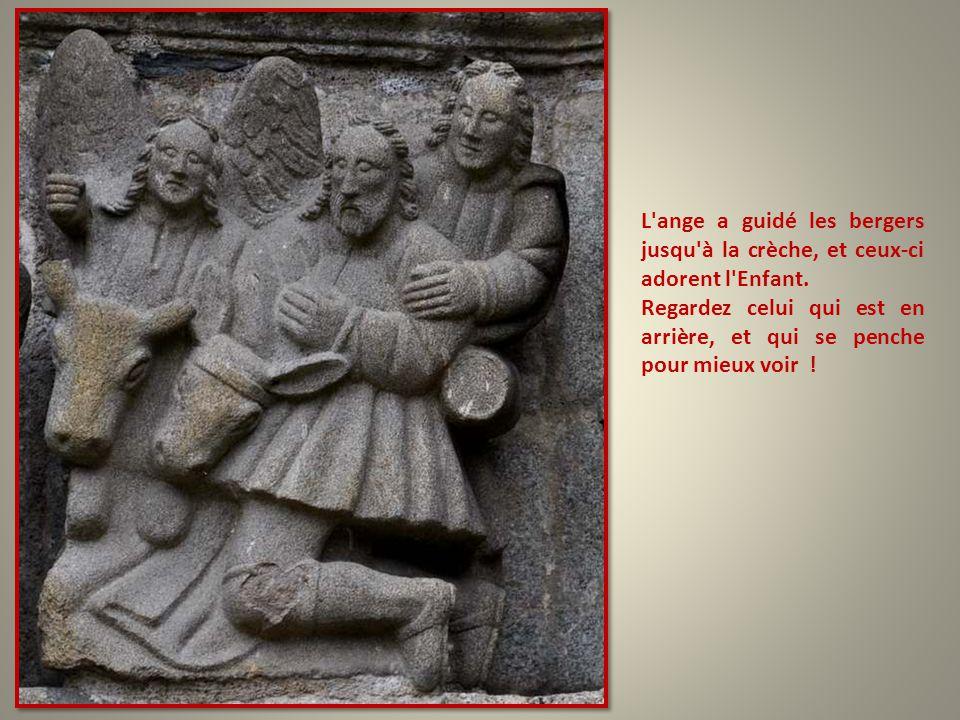 L ange a guidé les bergers jusqu à la crèche, et ceux-ci adorent l Enfant.