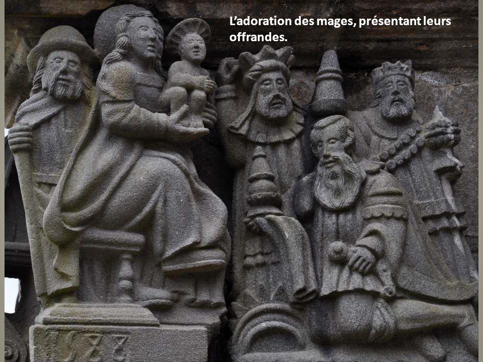 L'adoration des mages, présentant leurs offrandes.