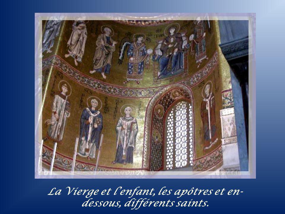 La Vierge et l'enfant, les apôtres et en-dessous, différents saints.