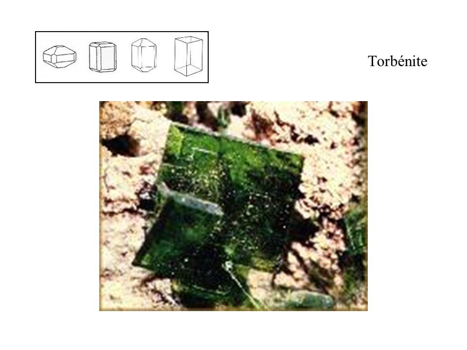 Torbénite Micas uranifères, la couleur le plus fréquente est le vert émeraude. Le plus souvent en cristaux tabulaires parfaitement délimités.