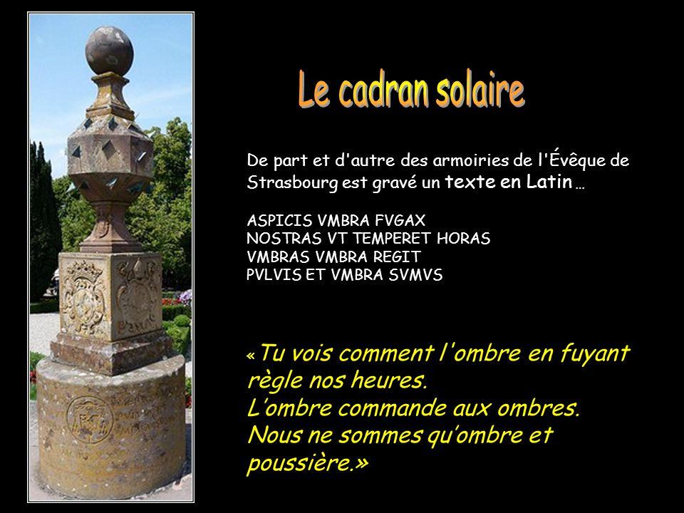 Le cadran solaire De part et d autre des armoiries de l Évêque de Strasbourg est gravé un texte en Latin …
