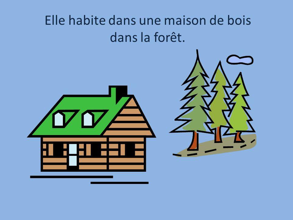 Elle habite dans une maison de bois