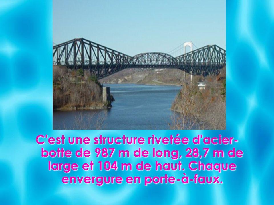 C est une structure rivetée d acier-botte de 987 m de long, 28,7 m de large et 104 m de haut.