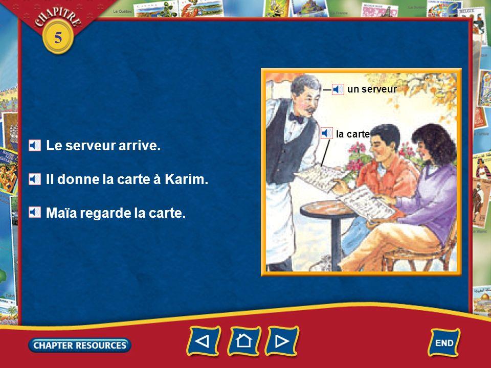 Il donne la carte à Karim.