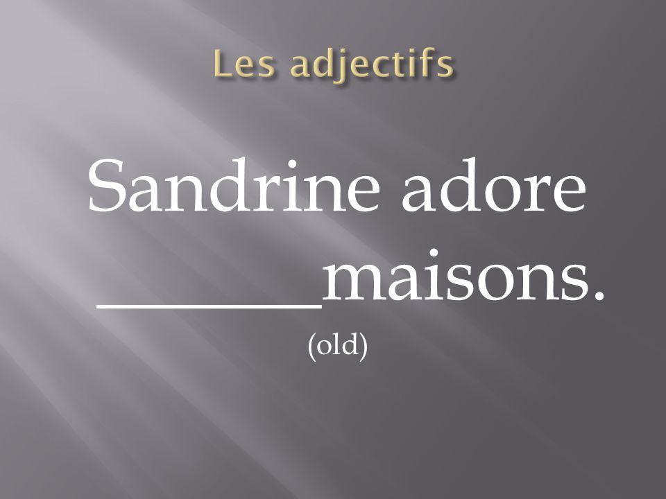 Sandrine adore ______maisons.