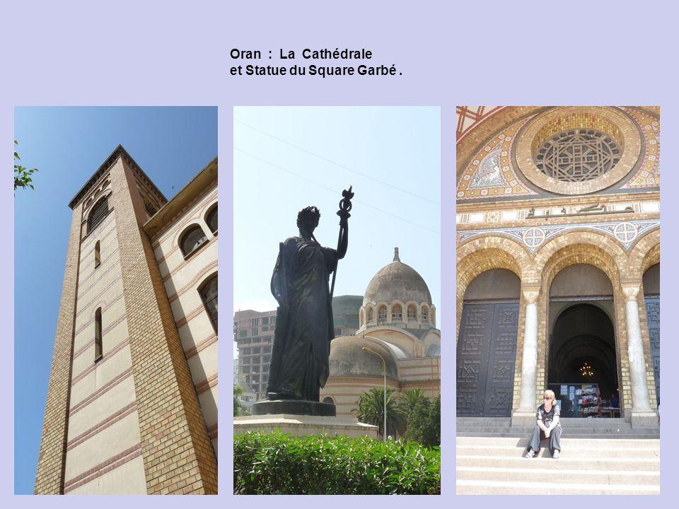 Oran : La Cathédrale et Statue du Square Garbé .