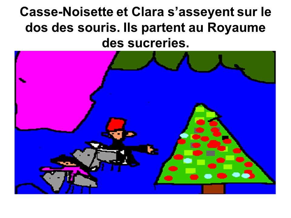 Casse-Noisette et Clara s'asseyent sur le dos des souris