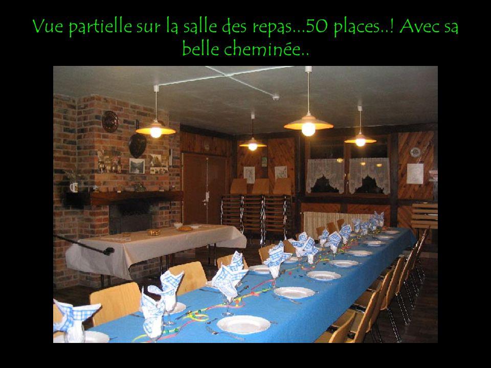 Vue partielle sur la salle des repas...50 places..! Avec sa belle cheminée..