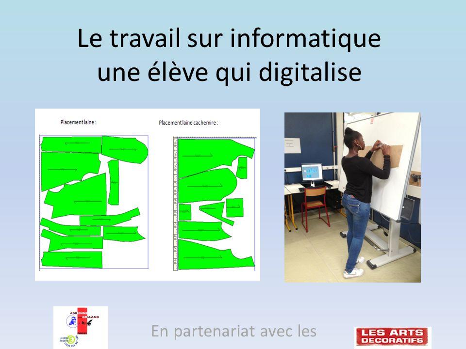Le travail sur informatique une élève qui digitalise