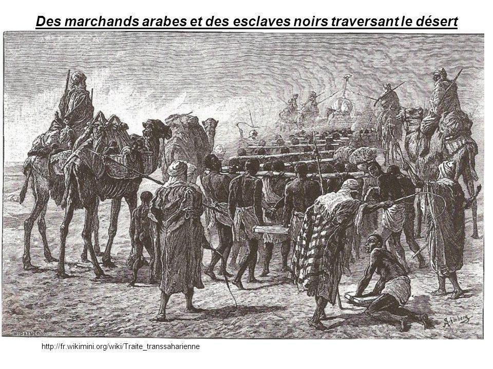 Des marchands arabes et des esclaves noirs traversant le désert