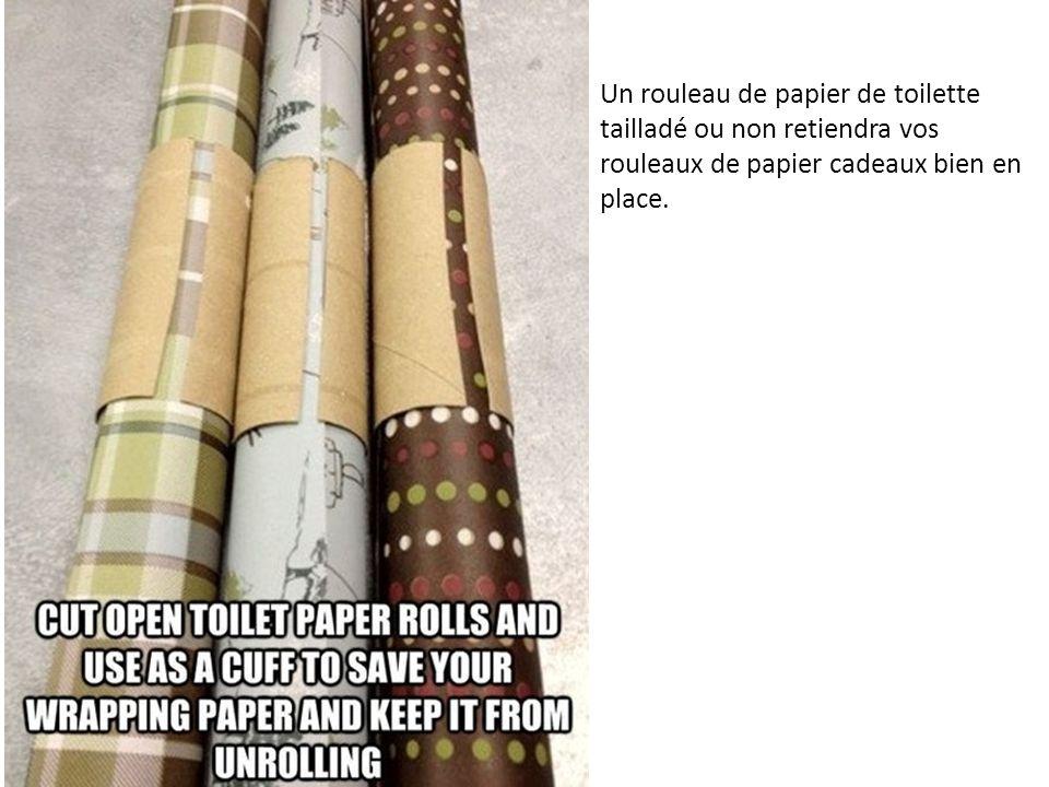 Un rouleau de papier de toilette tailladé ou non retiendra vos rouleaux de papier cadeaux bien en place.