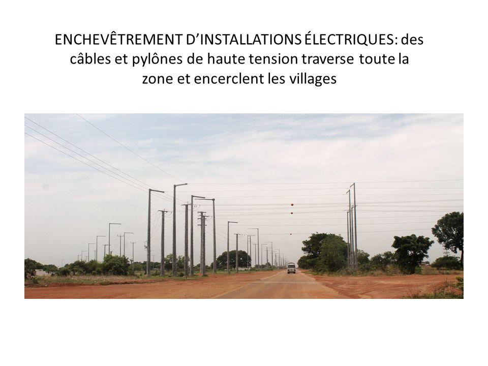 ENCHEVÊTREMENT D'INSTALLATIONS ÉLECTRIQUES: des câbles et pylônes de haute tension traverse toute la zone et encerclent les villages