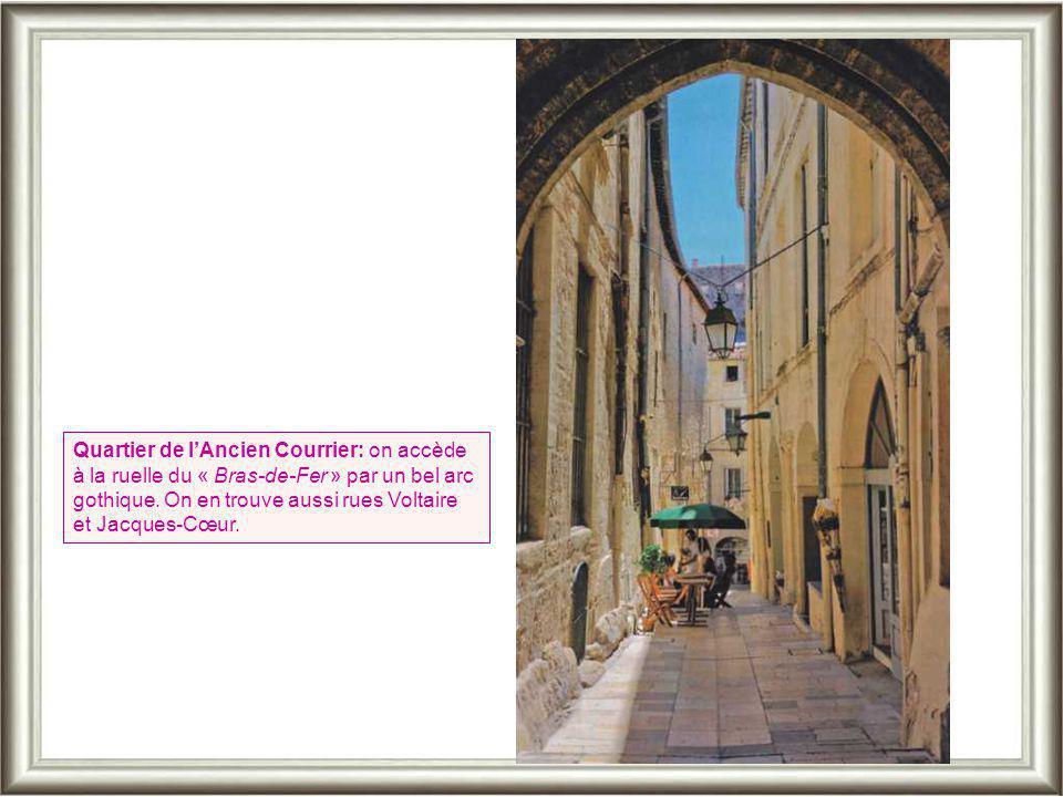 Quartier de l'Ancien Courrier: on accède à la ruelle du « Bras-de-Fer » par un bel arc gothique.