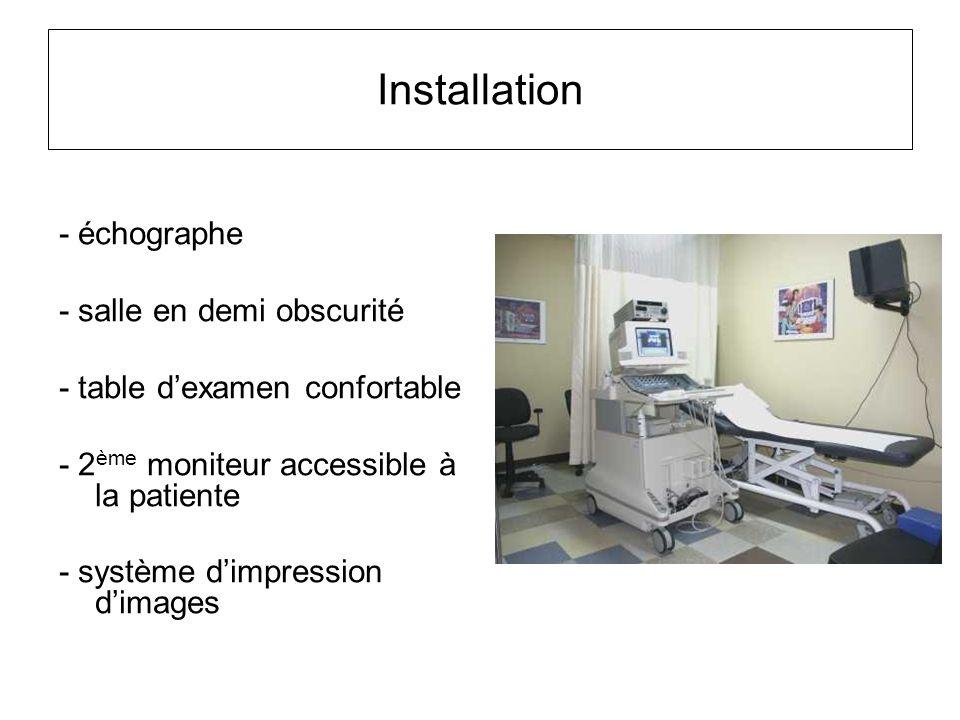 Installation - échographe - salle en demi obscurité
