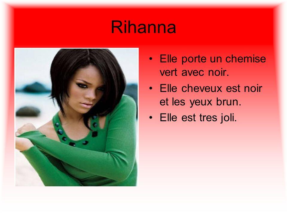 Rihanna Elle porte un chemise vert avec noir.