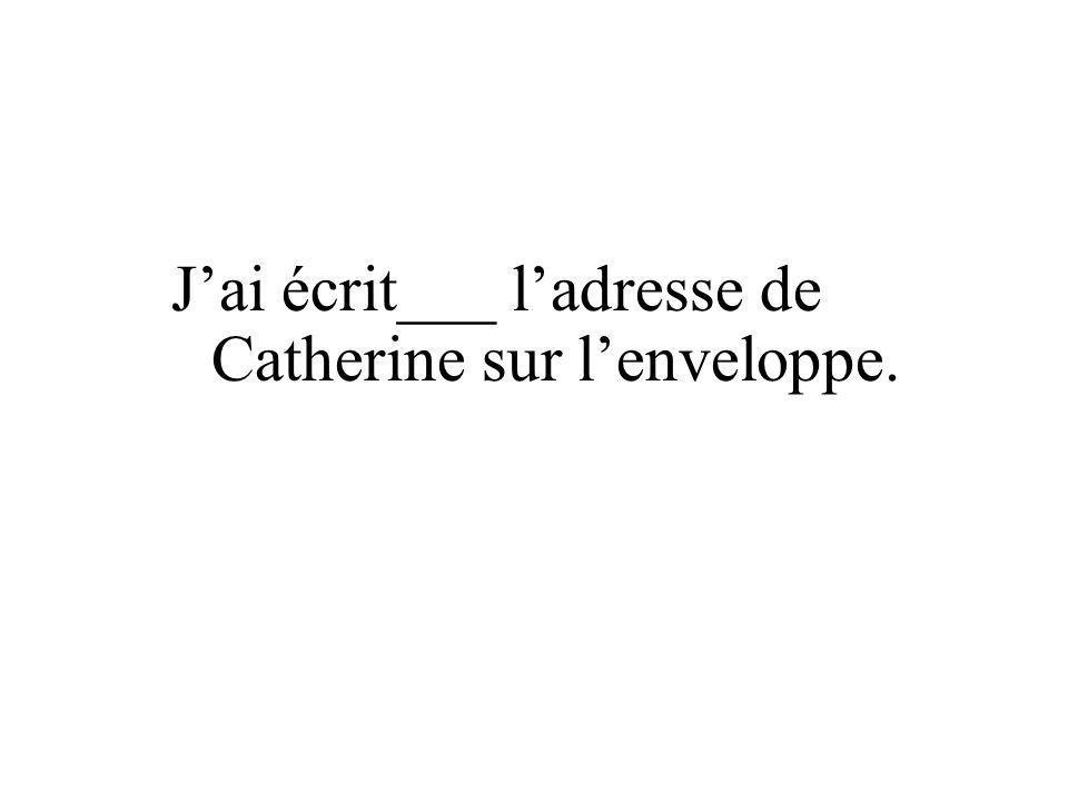 J'ai écrit___ l'adresse de Catherine sur l'enveloppe.