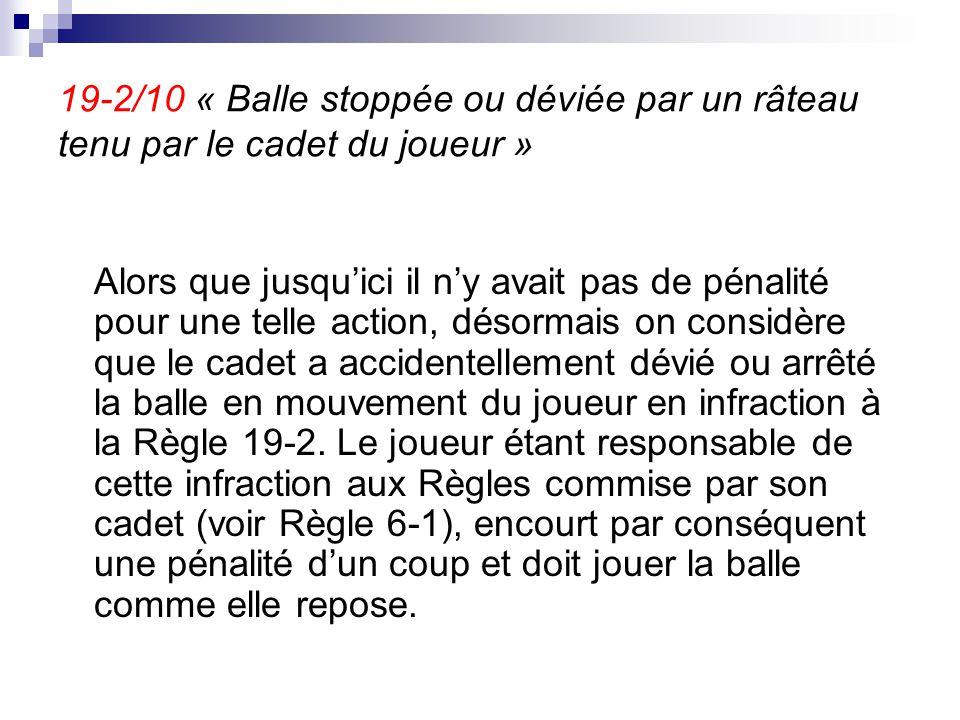 19-2/10 « Balle stoppée ou déviée par un râteau tenu par le cadet du joueur »