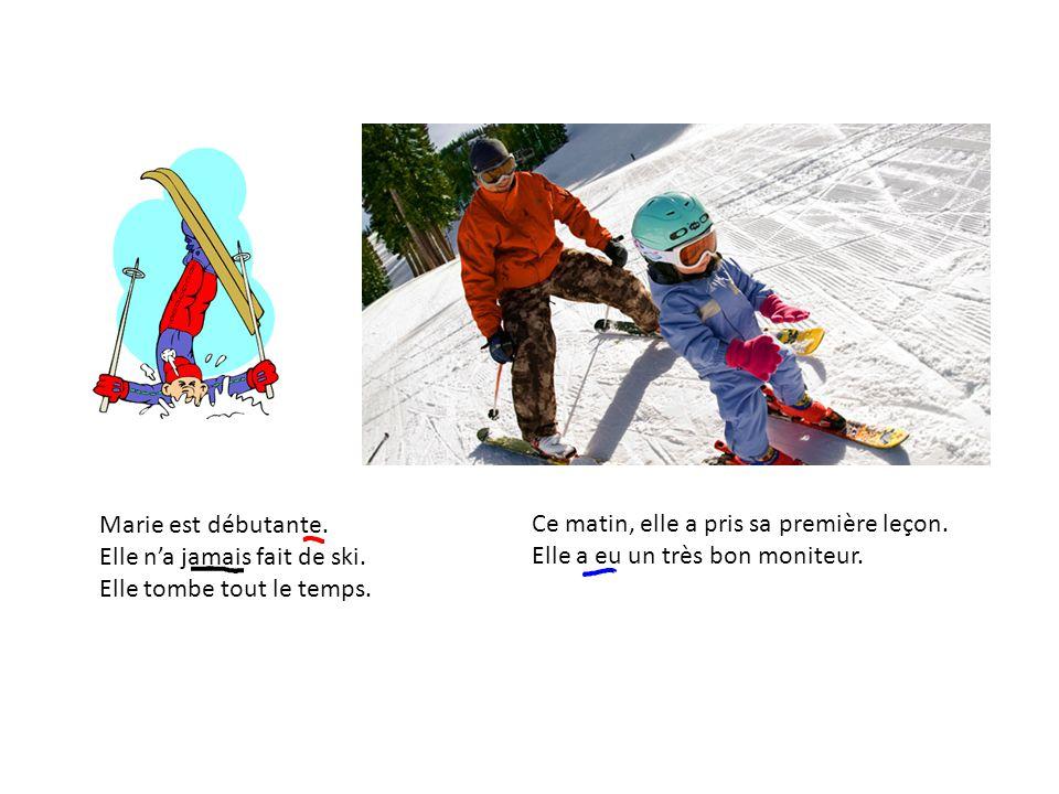 Marie est débutante. Elle n'a jamais fait de ski. Elle tombe tout le temps. Ce matin, elle a pris sa première leçon.