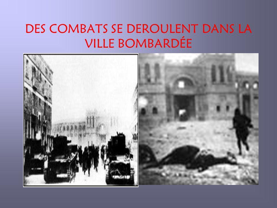 DES COMBATS SE DEROULENT DANS LA VILLE BOMBARDÉE
