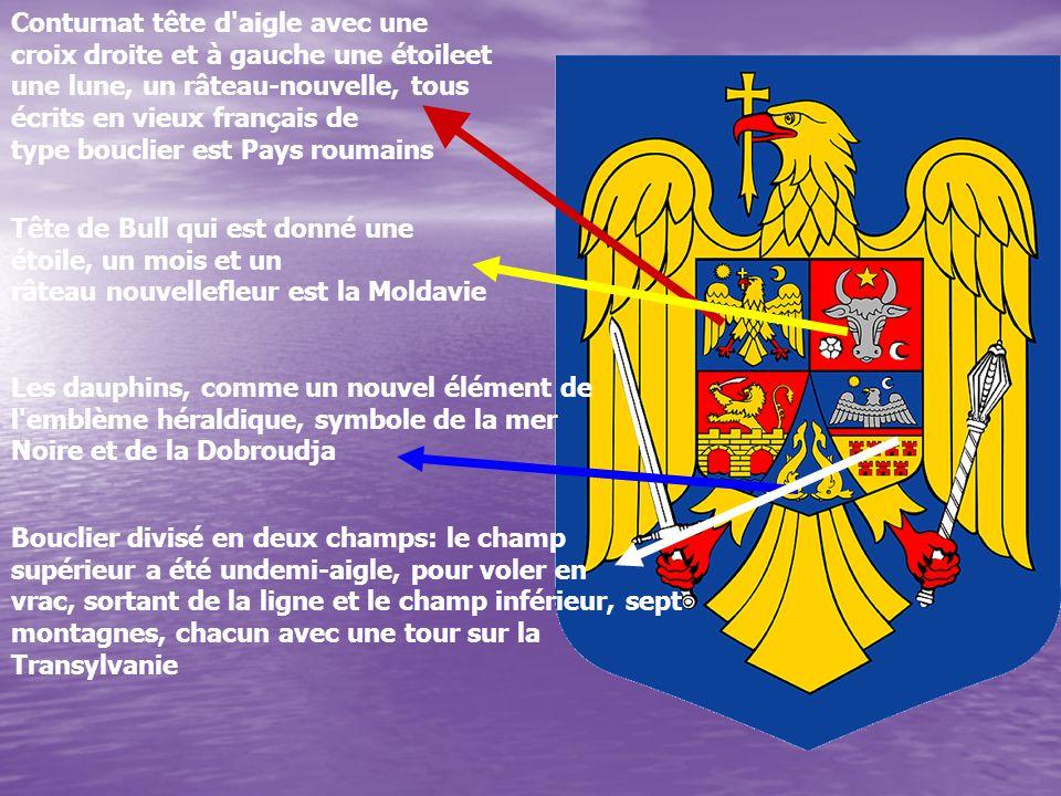 Conturnat tête d aigle avec une croix droite et à gauche une étoileet une lune, un râteau-nouvelle, tous écrits en vieux français de type bouclier est Pays roumains