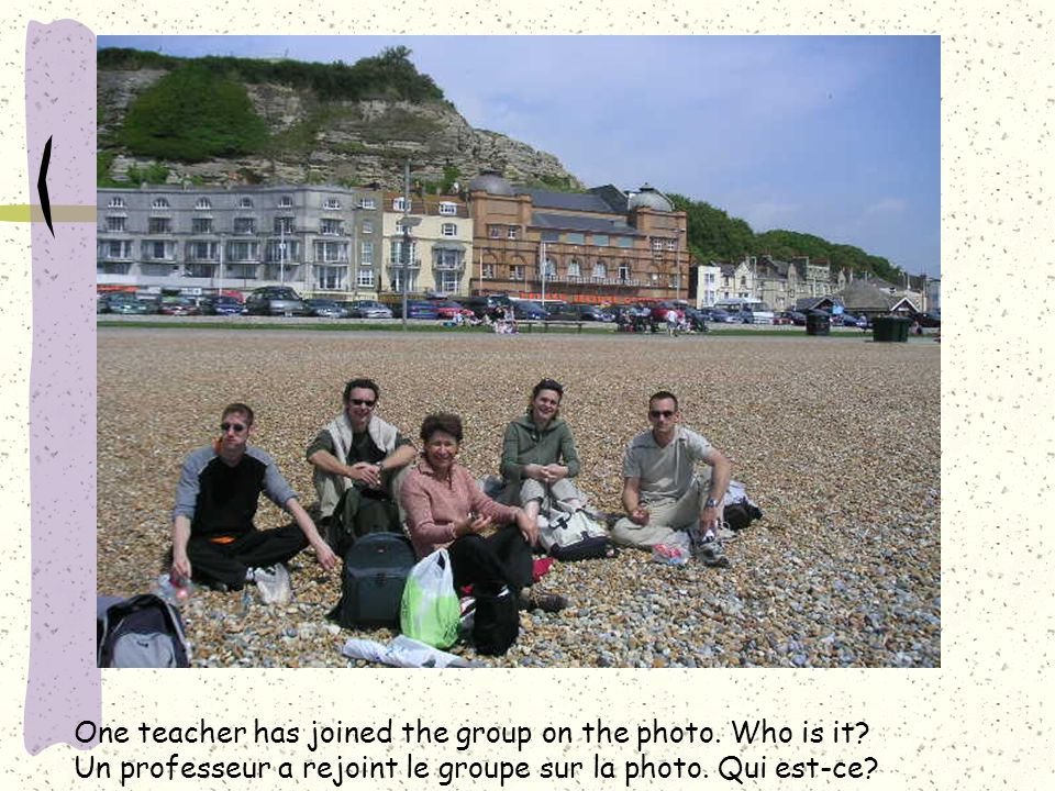One teacher has joined the group on the photo. Who is it