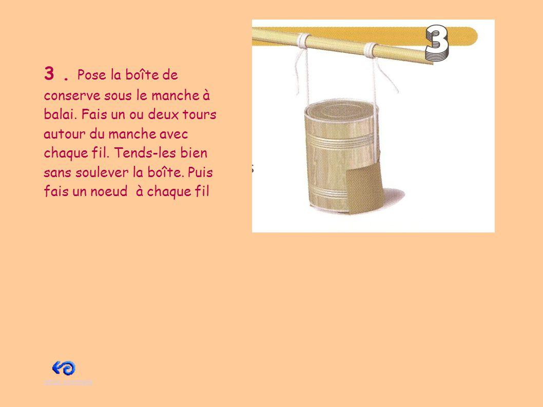 3. Pose la boîte de conserve sous le manche à balai