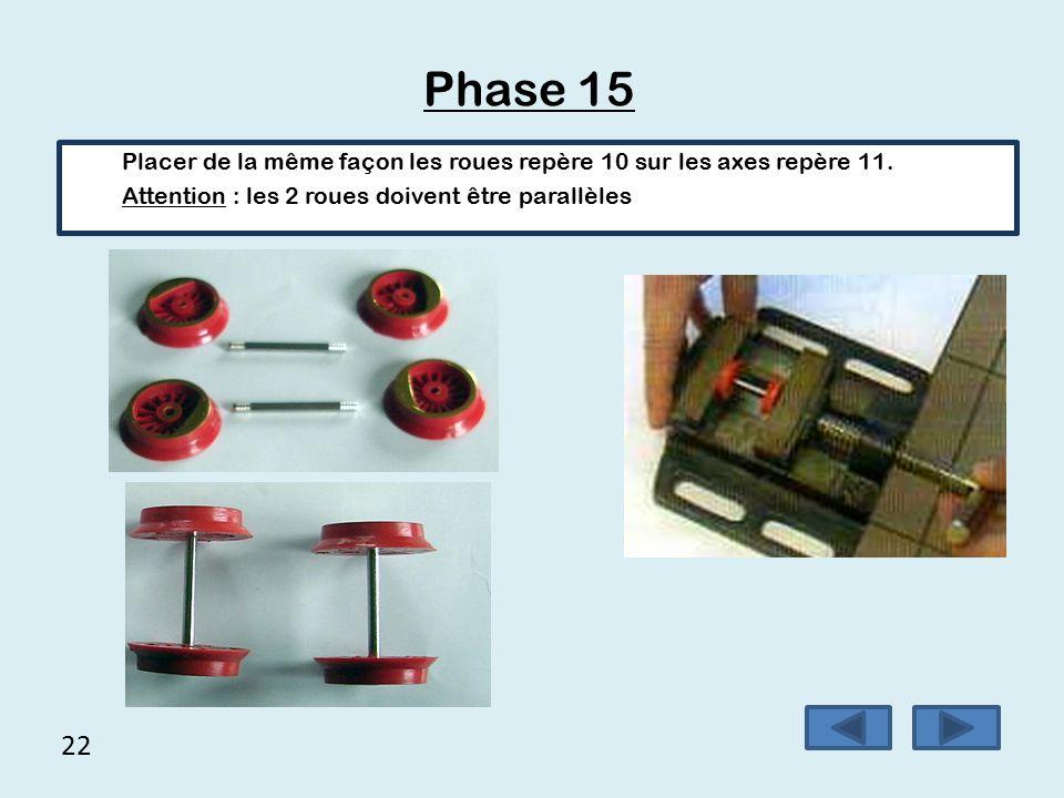 Phase 15 Placer de la même façon les roues repère 10 sur les axes repère 11. Attention : les 2 roues doivent être parallèles.