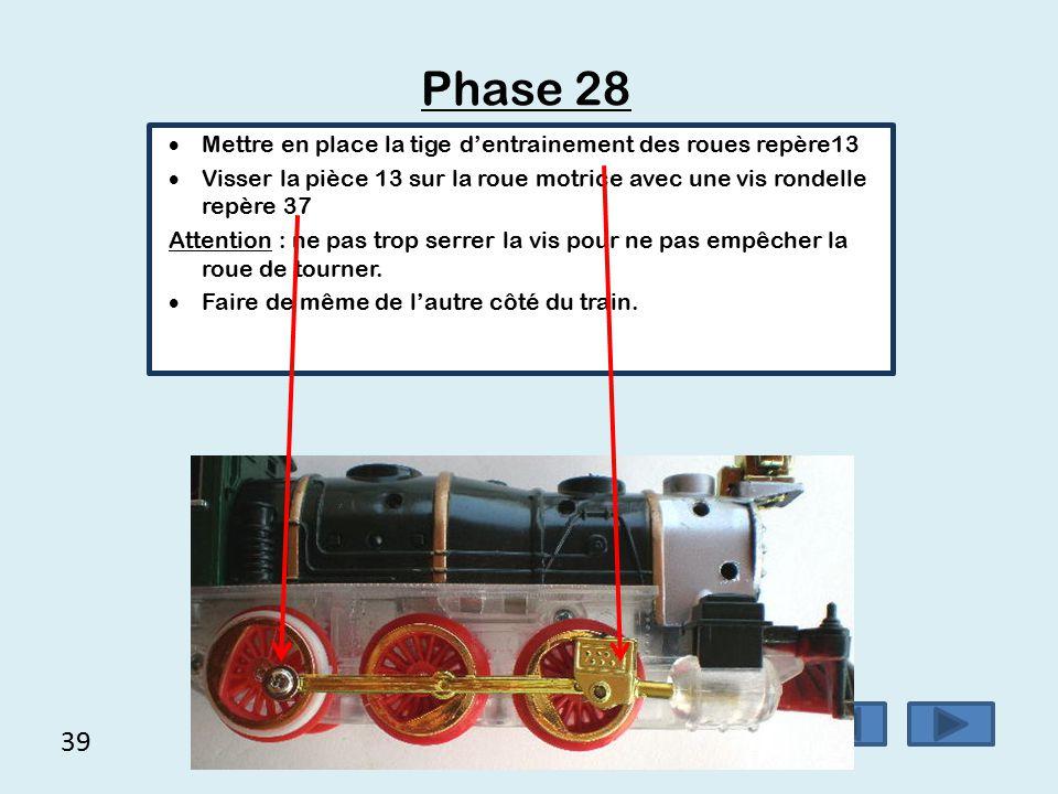 Phase 28 39 Mettre en place la tige d'entrainement des roues repère13
