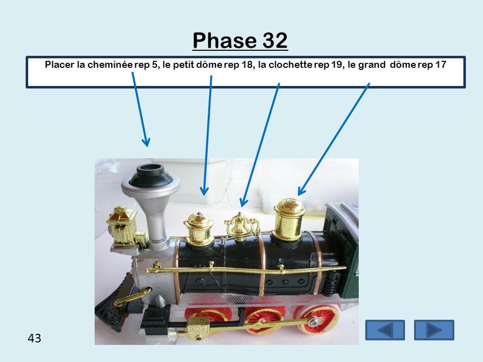 Phase 32 Placer la cheminée rep 5, le petit dôme rep 18, la clochette rep 19, le grand dôme rep 17.