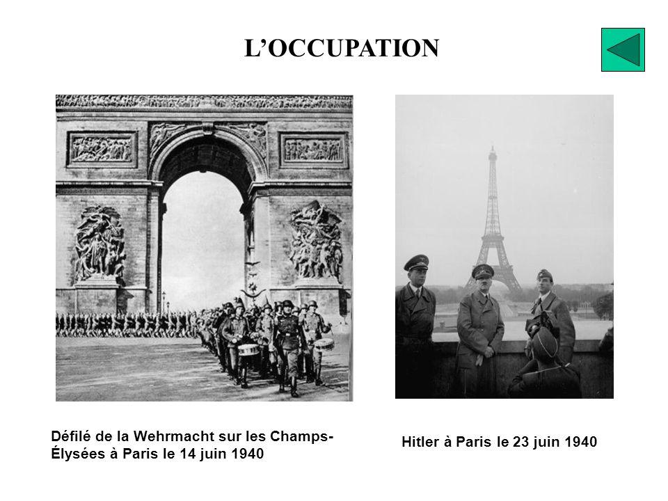 L'OCCUPATION Défilé de la Wehrmacht sur les Champs- Élysées à Paris le 14 juin 1940.