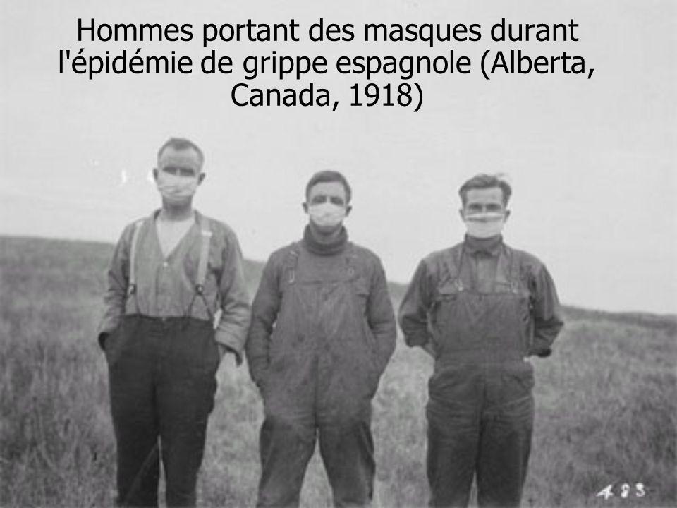 Hommes portant des masques durant l épidémie de grippe espagnole (Alberta, Canada, 1918)