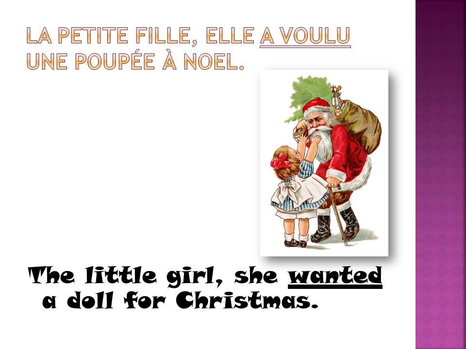 La petite fille, elle a voulu une poupée à noel.