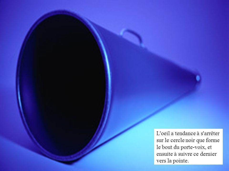 L oeil a tendance à s arrêter sur le cercle noir que forme le bout du porte-voix, et ensuite à suivre ce dernier vers la pointe.