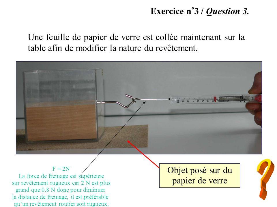 Exercice n°3 / Question 3. Une feuille de papier de verre est collée maintenant sur la table afin de modifier la nature du revêtement.