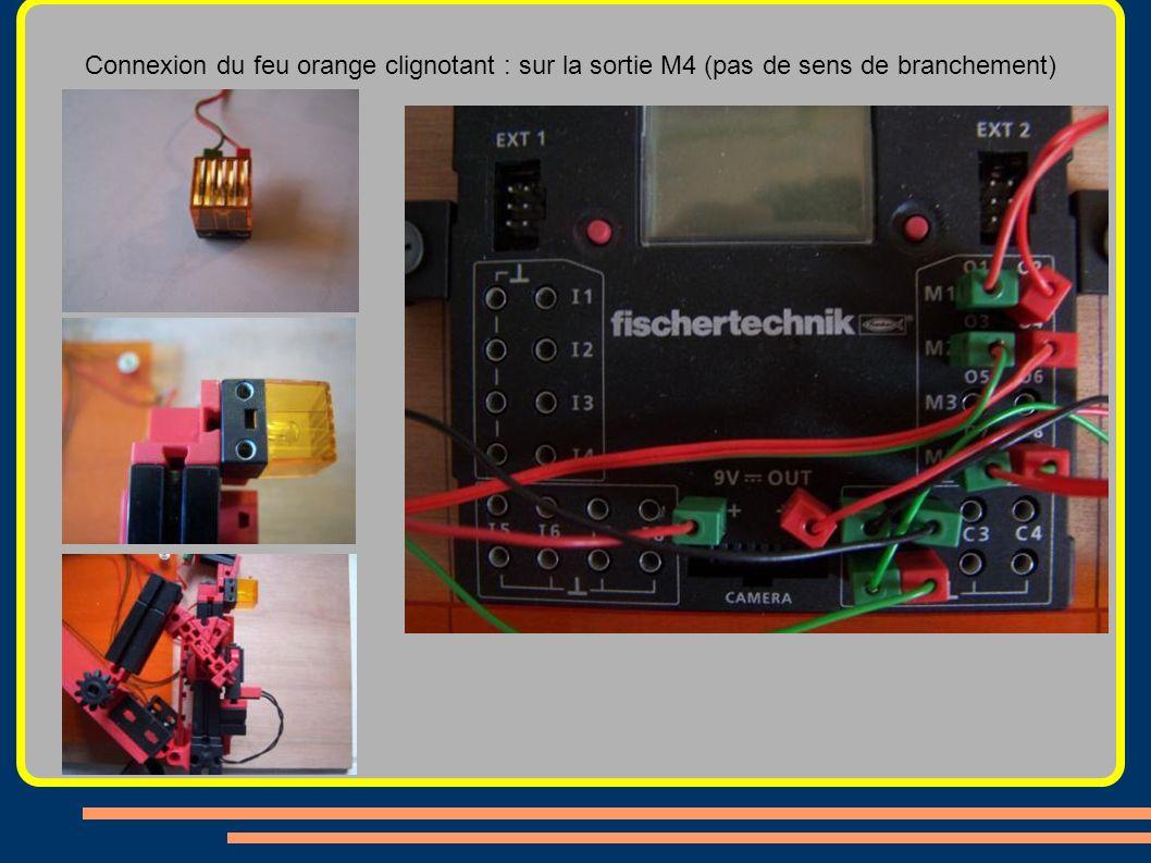 Connexion du feu orange clignotant : sur la sortie M4 (pas de sens de branchement)