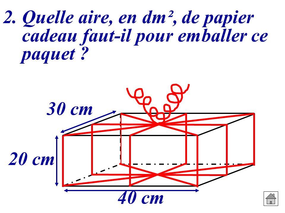 2. Quelle aire, en dm², de papier cadeau faut-il pour emballer ce paquet