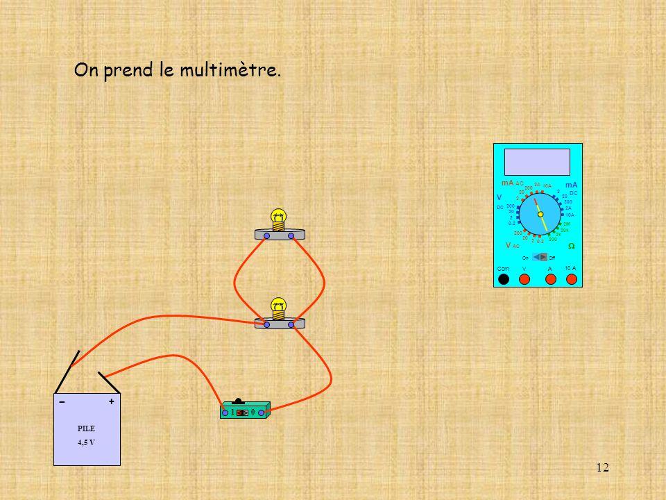 On prend le multimètre. - + mA AC mA V 1 PILE 4,5 V V AC W DC Com V A